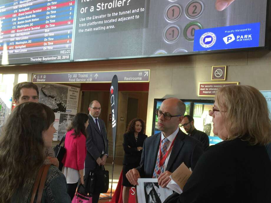 Connecticut Department of Transportation Bureau Chief for Public Transportation Richard Andreski, second from right, talks to Shore Line East commuters on Thursday, Sept. 20, 2018 in New Haven's Union Station about recent problems with the service. Photo: Mark Zaretsky / Hearst Connecticut Media