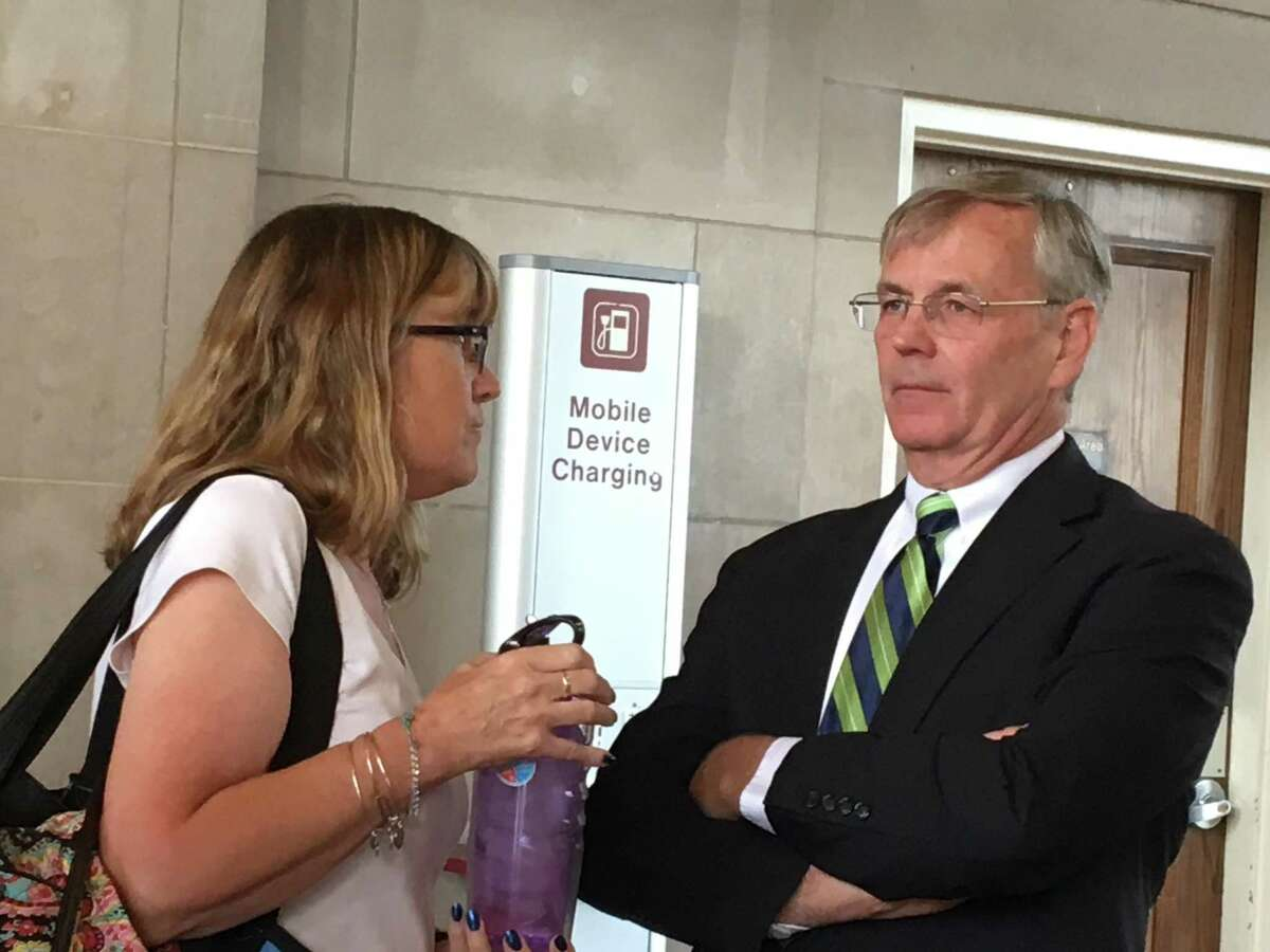 Connecticut Department of Transportation James Redeker speaks to Shore Line East commuterJeri Duefrene of the Niantic section of East Lyme. DOT officials, including Redeker, met with Shore Line East riders on Thursday, Sept. 20, 2018 in New Haven's Union Station to talk about recent problems with the service.