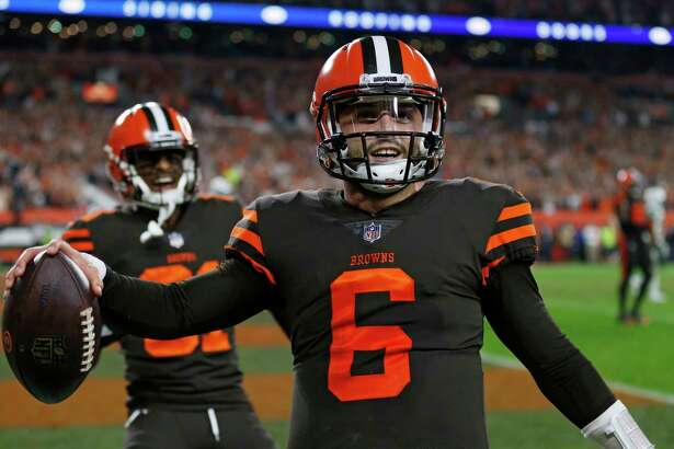 Cleveland Browns quarterback Baker Mayfield celebrates after scoring a 2-point conversion during the second half of an NFL football game against the New York Jets, Thursday, Sept. 20, 2018, in Cleveland. (AP Photo/Ron Schwane)
