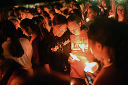 Members of the community came together Sept. 20, 2018, for a candlelight vigil honoring Lee High school student athlete Essence Glover, who passed away after fainting during basketball practice the day before. James Durbin/Reporter-Telegram