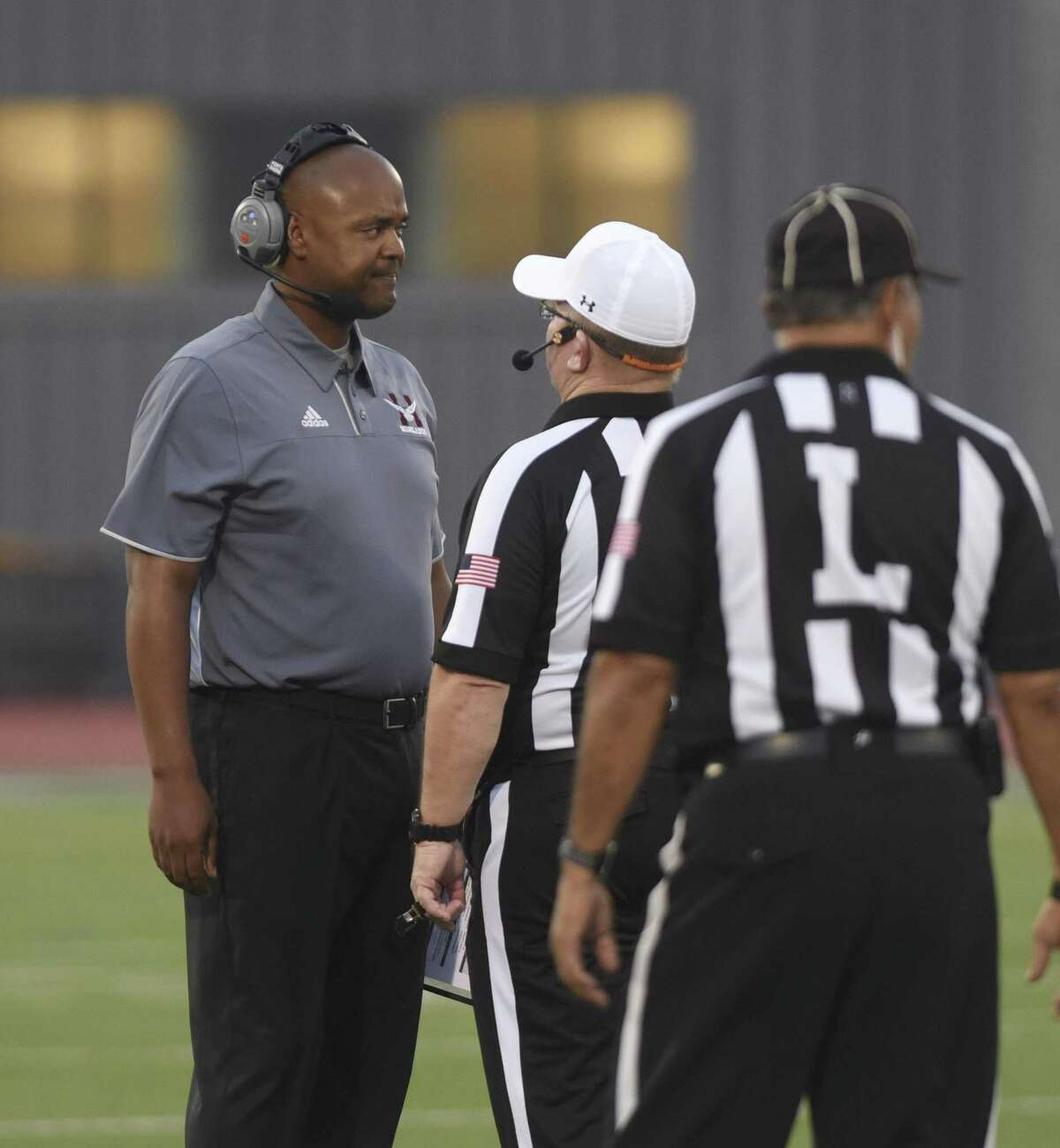 Highlands football coach Hank Willis speaks with officials during high school football action against Jefferson at Alamo Stadium on Thursday, Sept. 20, 2018. Willis said Tuesday he has resigned as Highlands football coach after three seasons.