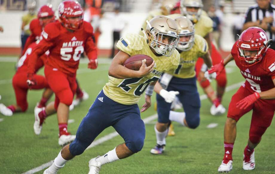 Alexander High School Carlo Canales runs the ball during a game against Martin High School on Thursday, Sept. 20, 2018 at Shirley Field. Photo: Danny Zaragoza /Laredo Morning Times / Laredo Morning Times