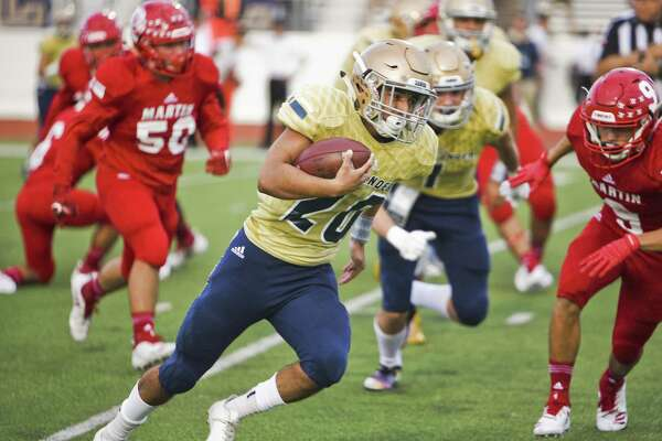 Alexander High School Carlo Canales runs the ball during a game against Martin High School on Thursday, Sept. 20, 2018 at Shirley Field.