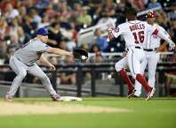 Washington Nationals' Victor Robles (16) is out at first by New York Mets first baseman Jay Bruce, left, during the third inning of a baseball game, Thursday, Sept. 20, 2018, in Washington. (AP Photo/Nick Wass)