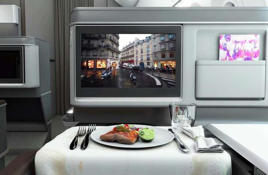 Business class seats come with 18-inch HD touchscreens. (Image: EVA) Photo: EVA