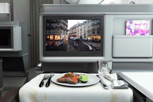 Business class seats come with 18-inch HD touchscreens. (Image: EVA)