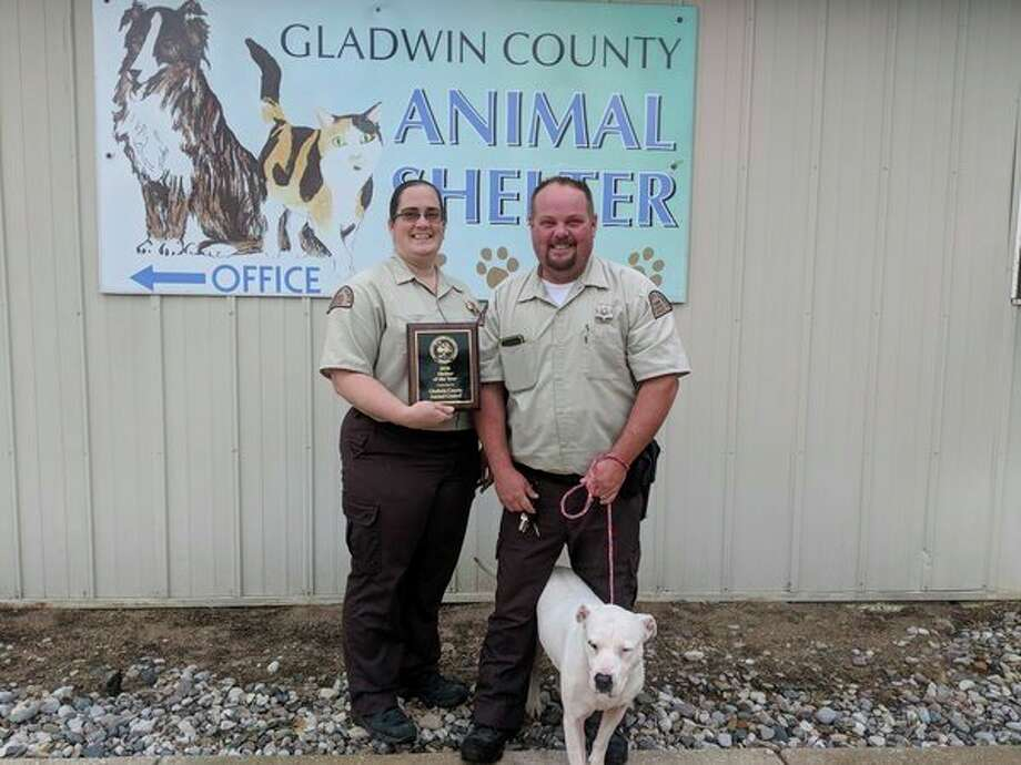 Gladwin County Animal Shelter Officer Jim Maveal, right, and Assistant Officer Krystal Moore are honored by their recent '2018 Shelter of the Year' award from the Michigan Association of Animal Control Officers.With them is Mama, a 7-year-old up for adoption. Mama is spayed, housebroken, calm and doesn't bark. Her adoption fee is paid. (Tereasa Nims/for the Daily News)