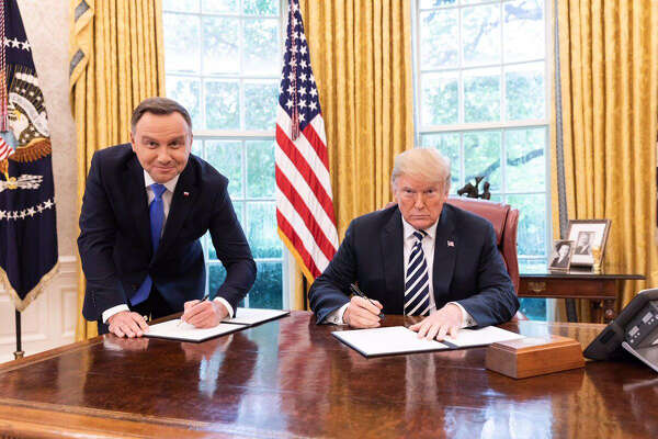 Polish President Andrzej Duda and U.S. President Donald Trump sign a strategic partnership pact at the White House on Sept. 18, 2018.