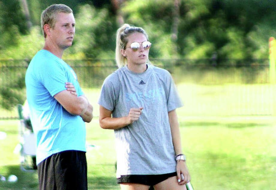 St. Louis Community College women's soccer head coach Jason Howard and his sister, assistant coach Nicole Howard, watch the action during Wednesday's game at Lewis and Clark Community College. Both are former LCCC players. Nicole Howard was NJCAA Player of the Year in 2015 and later transferred to LSU. Photo: Pete Hayes | The Telegraph