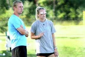 St. Louis Community College women's soccer head coach Jason Howard and his sister, assistant coach Nicole Howard, watch the action during Wednesday's game at Lewis and Clark Community College. Both are former LCCC players. Nicole Howard was NJCAA Player of the Year in 2015 and later transferred to LSU.