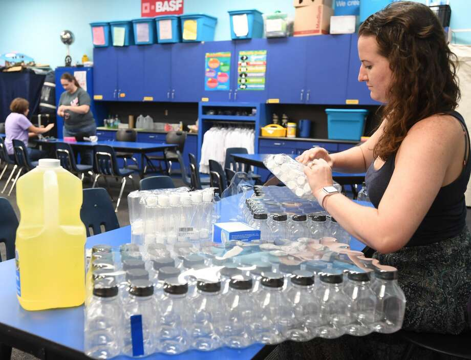 Christina Trujllo prepares small lava lamps Thursday for Friday's Women in STEM event at the Beaumont Children's Museum. Photo taken Thursday, 9/20/18 Photo: Guiseppe Barranco/The Enterprise