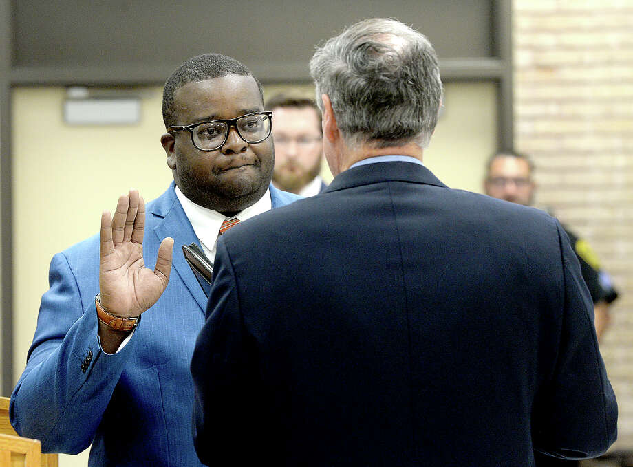 Alexandrew Seale is sworn in by Judge John Stevens during the BISD board meeting at the administration building Thursday. Seale will fill the vacancy left by board of managers president Joe Domino, who resigned in June. Thursday, September 20, 2018 Kim Brent/The Enterprise Photo: Kim Brent/The Enterprise