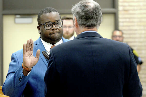 Alexandrew Seale is sworn in by Judge John Stevens during the BISD board meeting at the administration building Thursday. Seale will fill the vacancy left by board of managers president Joe Domino, who resigned in June. Thursday, September 20, 2018 Kim Brent/The Enterprise