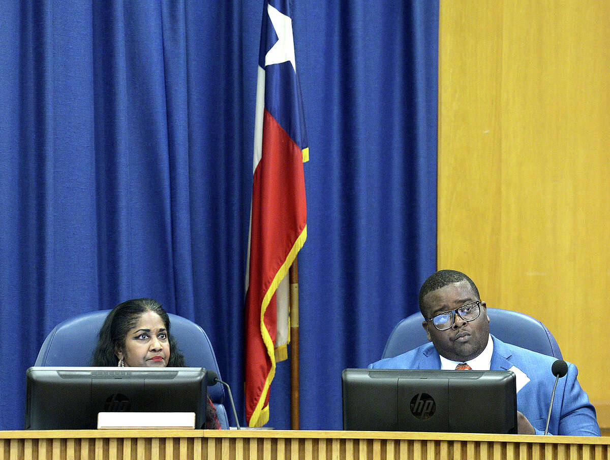 Alexandrew Seale looks on with with Denise Wallace-Spooner after he takes his seat following his swearing in by Judge John Stevens during the BISD board meeting at the administration building Thursday. Seale will fill the vacancy left by board of managers president Joe Domino, who resigned in June. Thursday, September 20, 2018 Kim Brent/The Enterprise