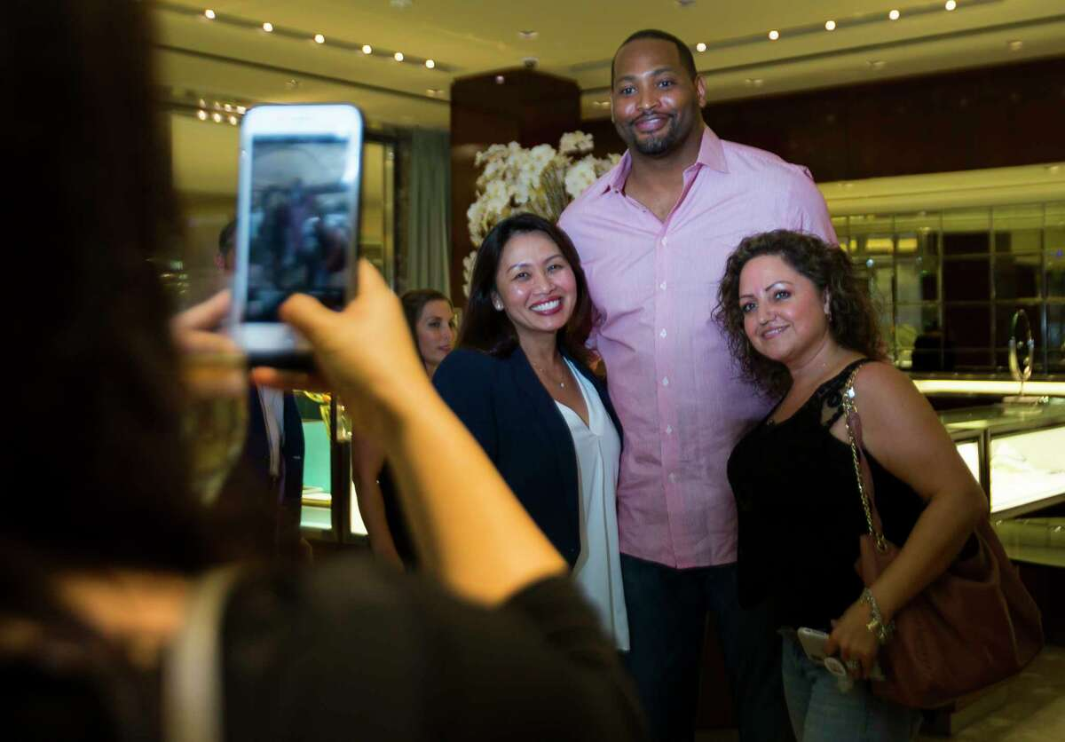Former Rocket Robert Horry has his picture taken during a celebration of two new NBA Championship Larry O'Brien trophies commemorating the Rockets' back-to-back NBA titles in 1994 and 1995 at Tiffany & Co. in The Galleria, Thursday, Sept. 20, 2018 in Houston.