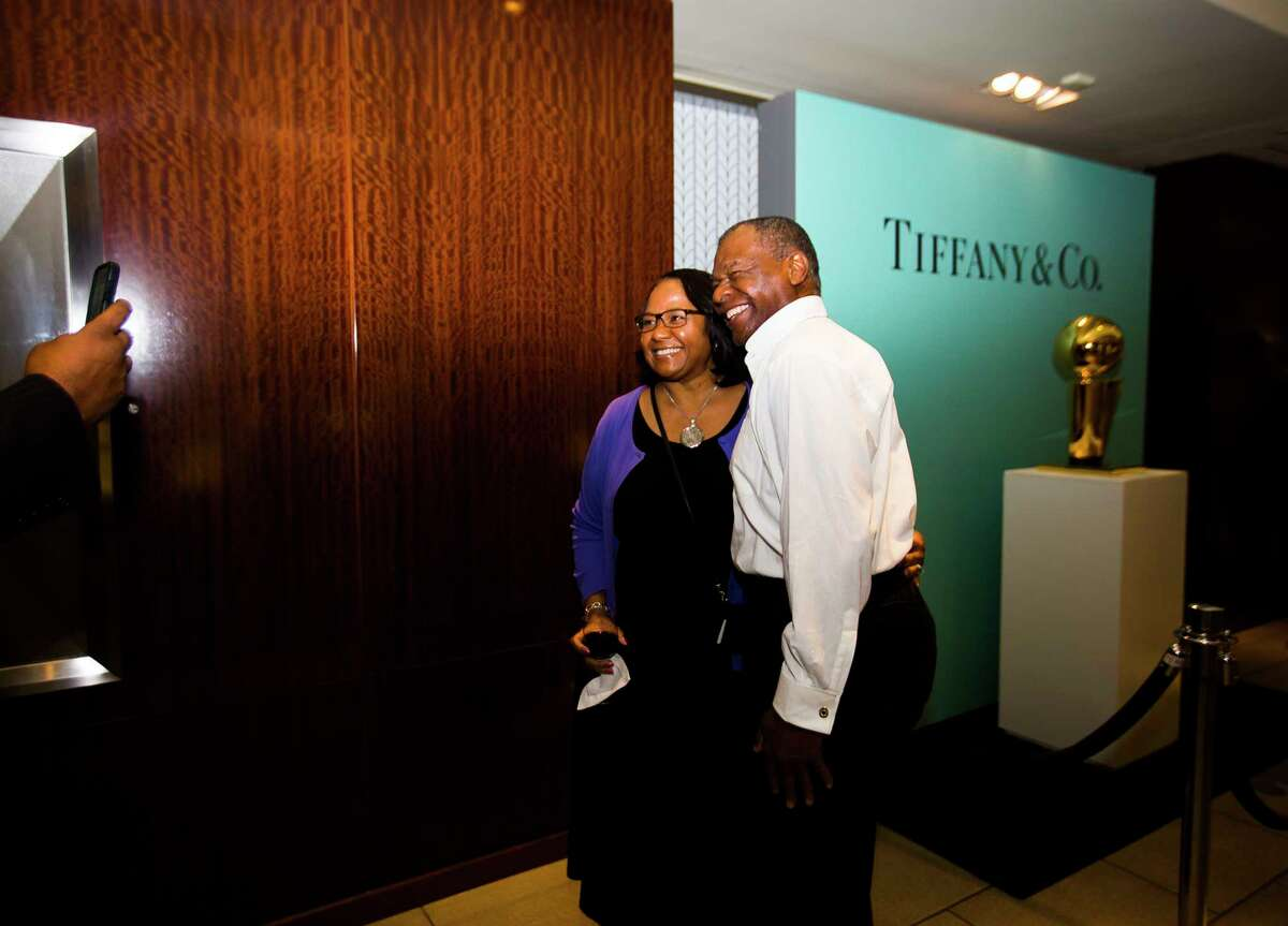 Karen Ray is photographed with former Rocket Calvin Murphy during a celebration of two new NBA Championship Larry O'Brien trophies commemorating the Rockets' back-to-back NBA titles in 1994 and 1995 at Tiffany & Co. in The Galleria, Thursday, Sept. 20, 2018 in Houston.