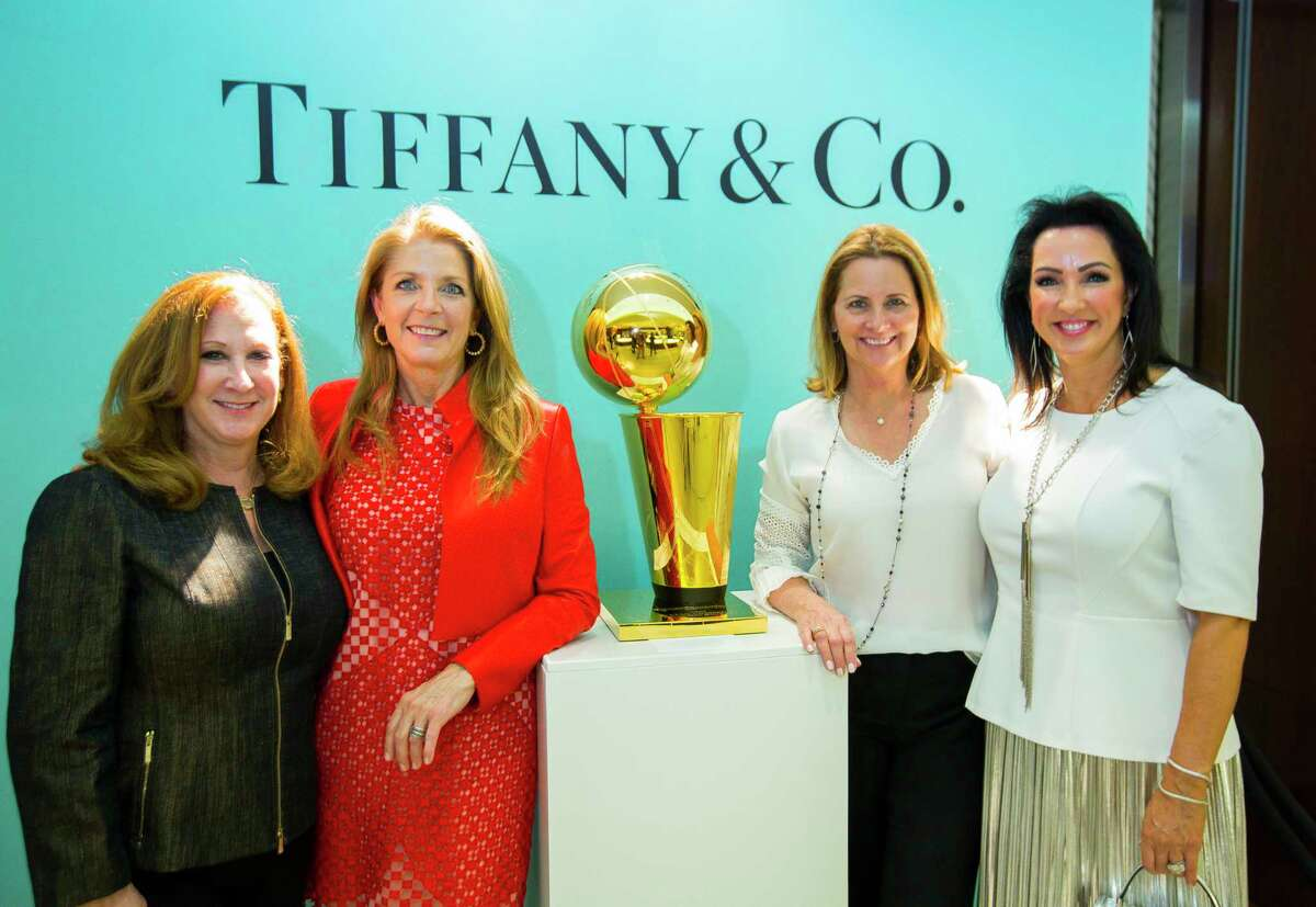 Sydney Shellenbarger, Paige Fertitta, Laurel D'Antoni and Alicia Smith enjoy a celebration of two new NBA Championship Larry O'Brien trophies commemorating the Rockets' back-to-back NBA titles in 1994 and 1995 at Tiffany & Co. in The Galleria, Thursday, Sept. 20, 2018 in Houston.