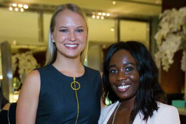Samantha Robison and Kaleé Garvin enjoy a celebration of two new NBA Championship Larry O'Brien trophies commemorating the Rockets' back-to-back NBA titles in 1994 and 1995 at Tiffany & Co. in The Galleria, Thursday, Sept. 20, 2018 in Houston.