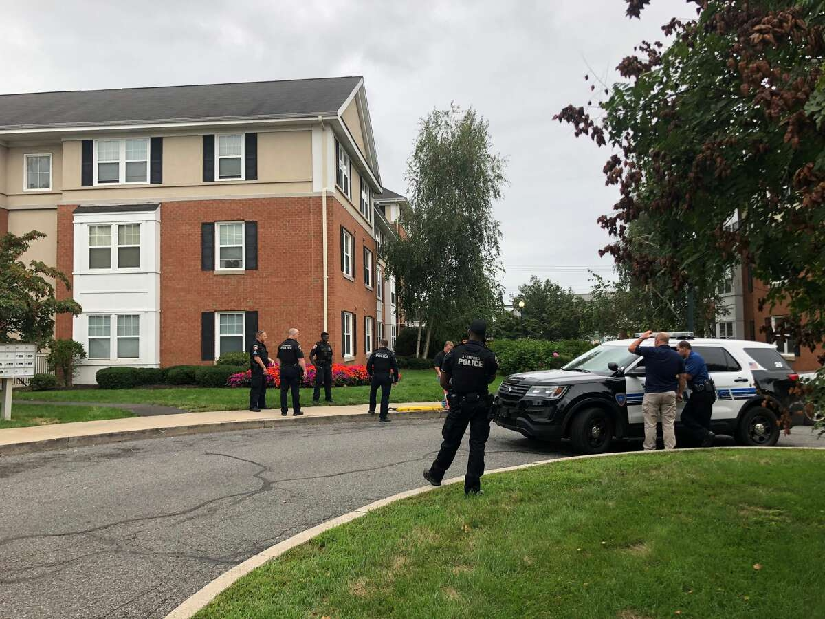 Police investigate a homicide at condo complex on Pequot Drive in Stamford on Friday, Sept. 21, 2018.