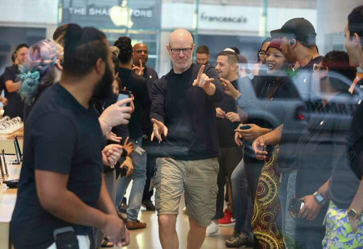 Highland Village Apple store staff rally before open its doors  for customers to buy new products on Friday, Sept. 21, 2018, in Houston. The newly released products included iPhone Xs, iPhone Xs Max, iPhone Xr and Watch Series 4.
