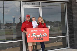 Bruce and Callie Redden with son Ryder at the site of the first i Fratelli Pizza in Houston.