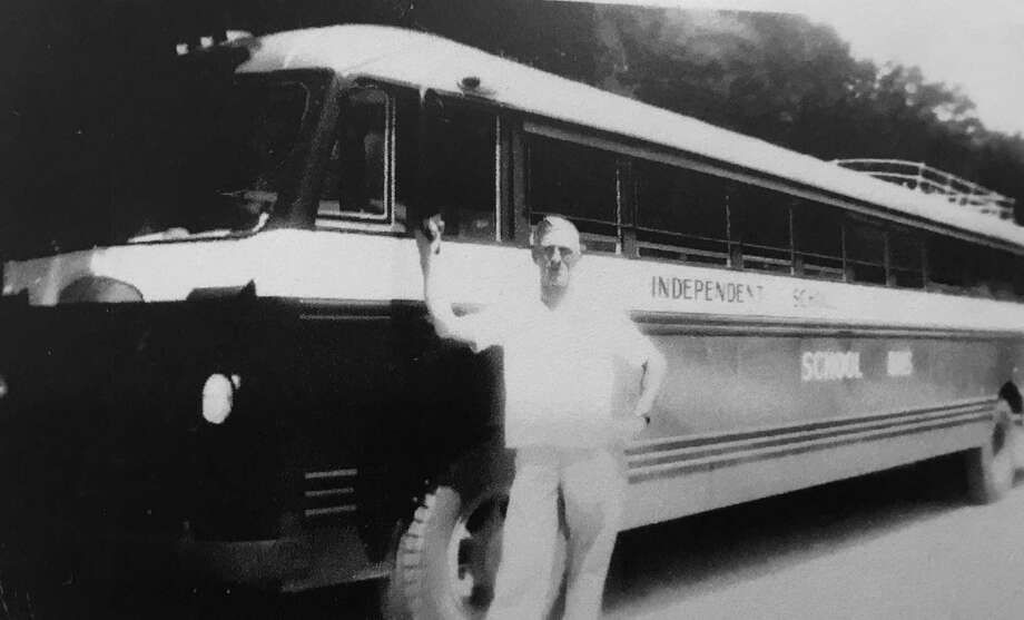 "Sam Doyal is pictured in front of the Conroe ISD school bus ""Little Lulu"" that picked up children from the oilfield camps southeast of Conroe. Photo: Photo Courtesy Peggy Isbell Hall"