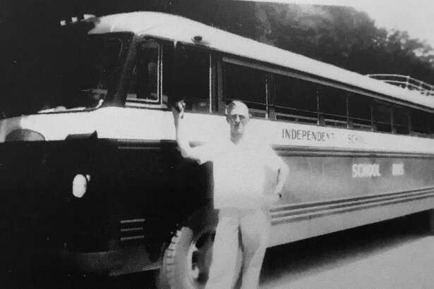 "Sam Doyal is pictured in front of the Conroe ISD school bus ""Little Lulu"" that picked up children from the oilfield camps southeast of Conroe."