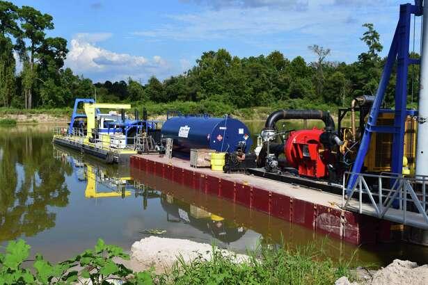 Crews began dredging the emergency dredging operation in theSan Jacinto River West Fork on Sept. 20.