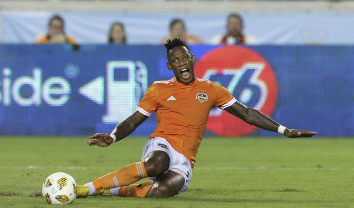 Houston Dynamo midfielder Romell Quioto (31) falls onto the ground after a push by Portland Timbers defender Larrys Mabiala (33) from behind during the second half of the MLS game at BBVA Compass Stadium on Saturday, Sept. 15, 2018, in Houston. The Houston Dynamo defeated the Portland Timbers 4-1.