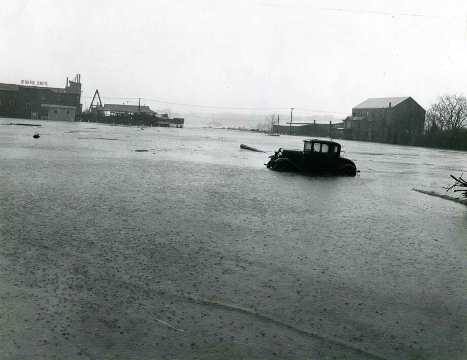 A photo of a flooded Steamboat Road looking south toward the ferry boat dock on Greenwich Harbor after the great hurricane of 1938 brought 80-mile-an-hour winds and a tidal wave to Greenwich shores, leaving devastation in its wake. Photo: Photo Courtesy / Greenwich Historical Society / Greenwich Time contributed