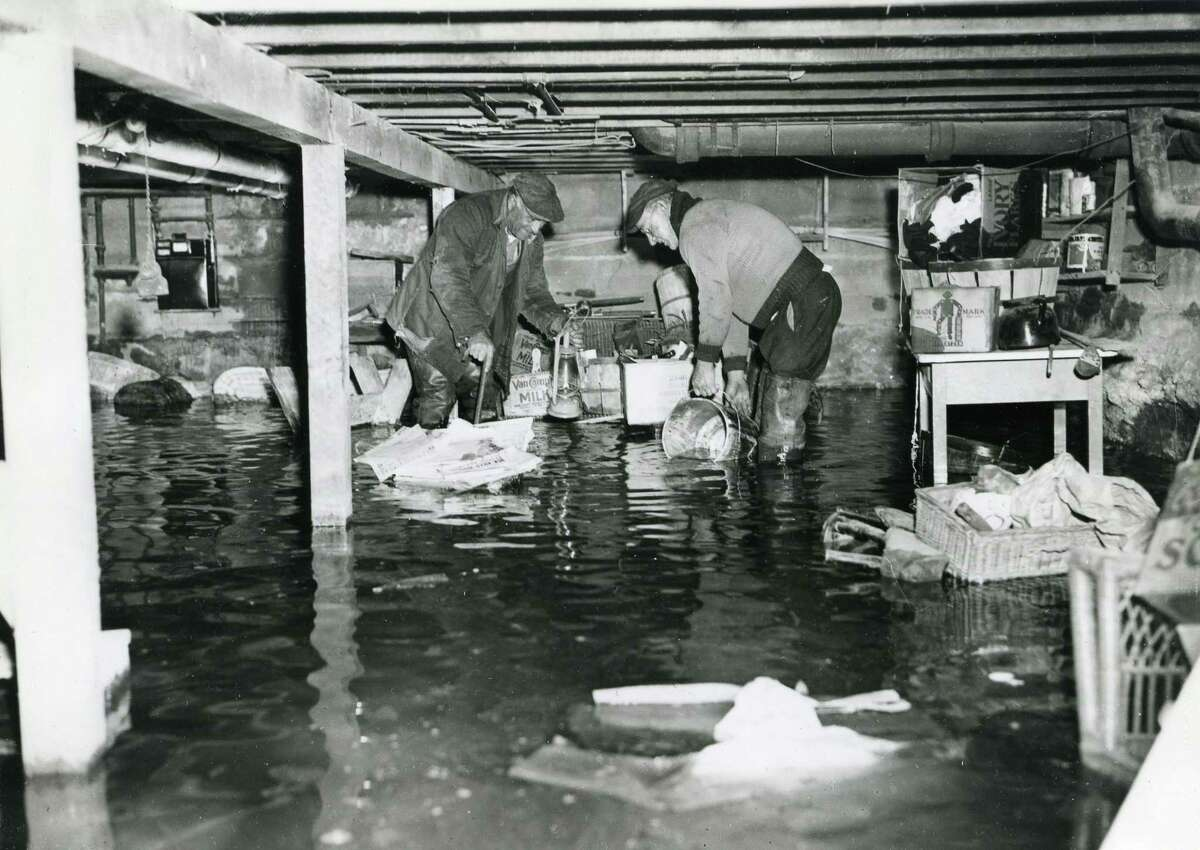 A flooded cellar in a neighborhood alnog the Byram River after the great hurricane of 1938 brought 80-mile-an-hour winds and a tidal wave to Greenwich shores leaving devastation in its wake.