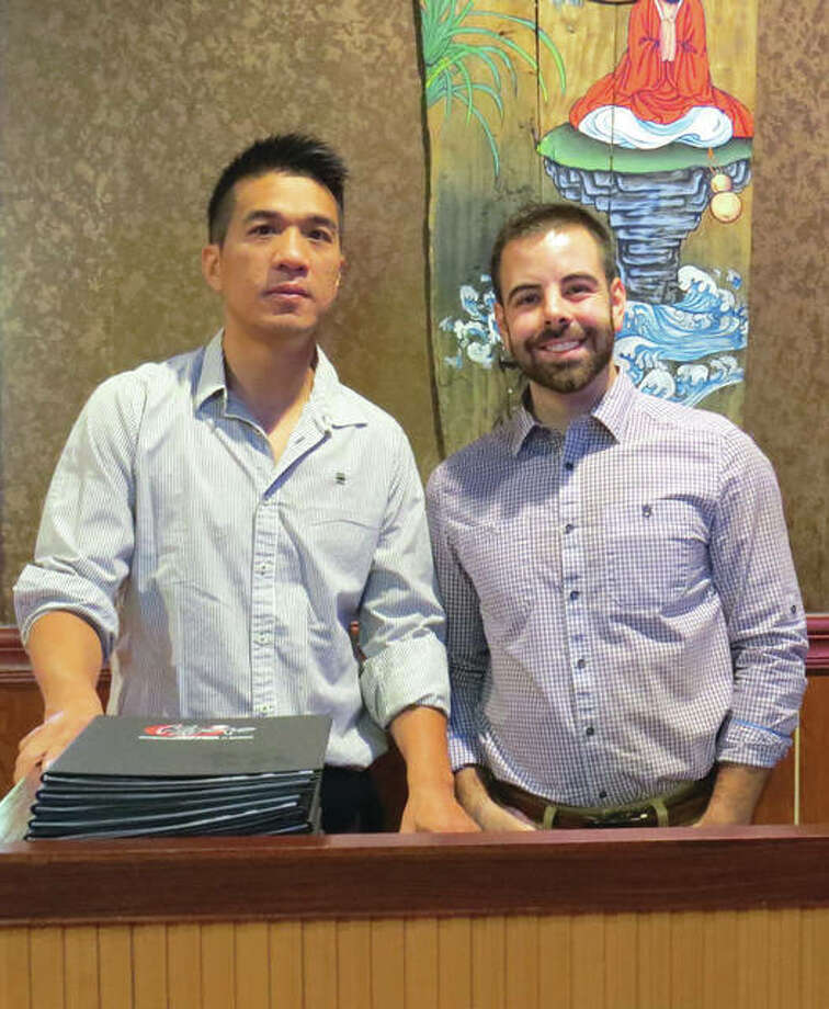 Owner James Pan and General Manager Bryson Weaver at the host stand at Kyoto, the new sushi steakhouse on Route 157 in Edwardsville. Photo: Carol Arnett/Intelligencer