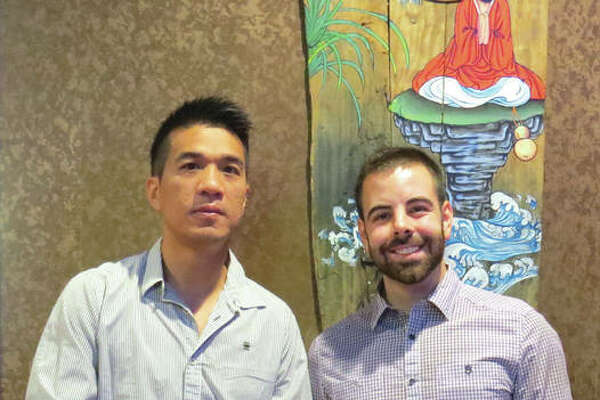 Owner James Pan and General Manager Bryson Weaver at the host stand at Kyoto, the new sushi steakhouse on Route 157 in Edwardsville.
