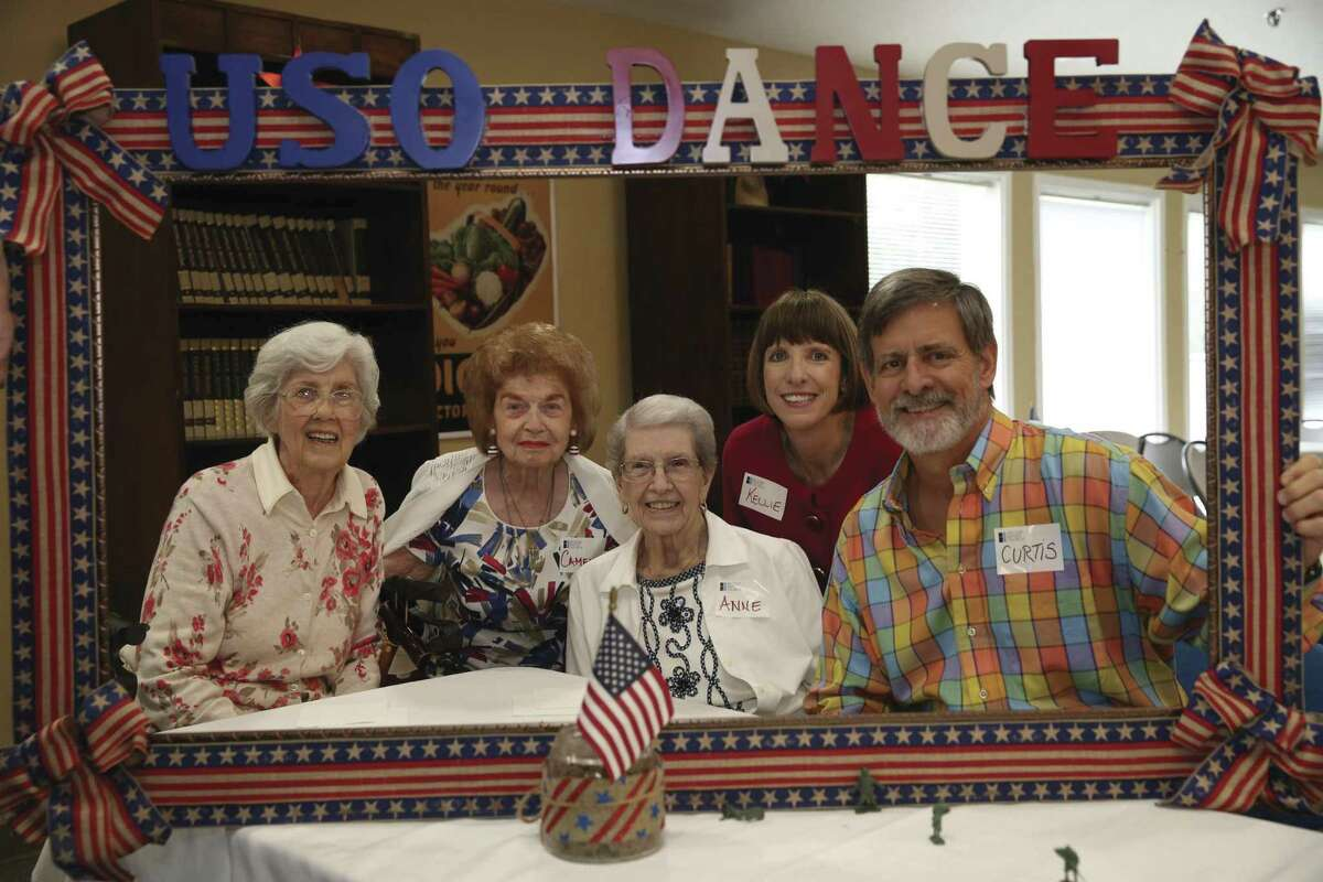 Treemont Retirement Community residents enjoy the USO Dance over July 4th weekend with the Heights Sunday School class volunteers from Second Baptist Church.
