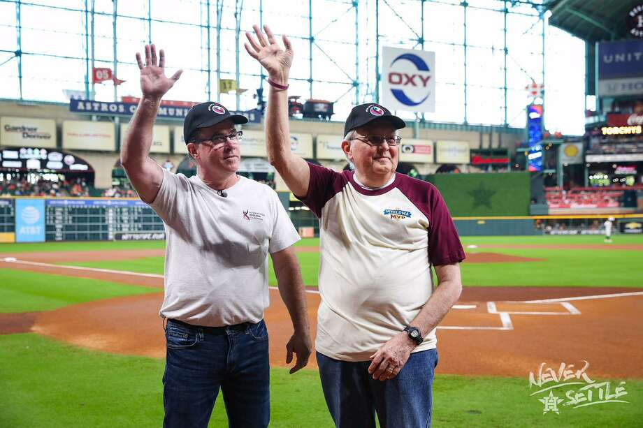 Kingwood resident Merlin Moseman (right) and Michael Tuohy (left) wave to Astros fans from the field at Minute Maid Park before the baseball game on Sunday, Sept. 16. Photo: Courtesy Of The Houston Astros / Courtesy Of The Houston Astros