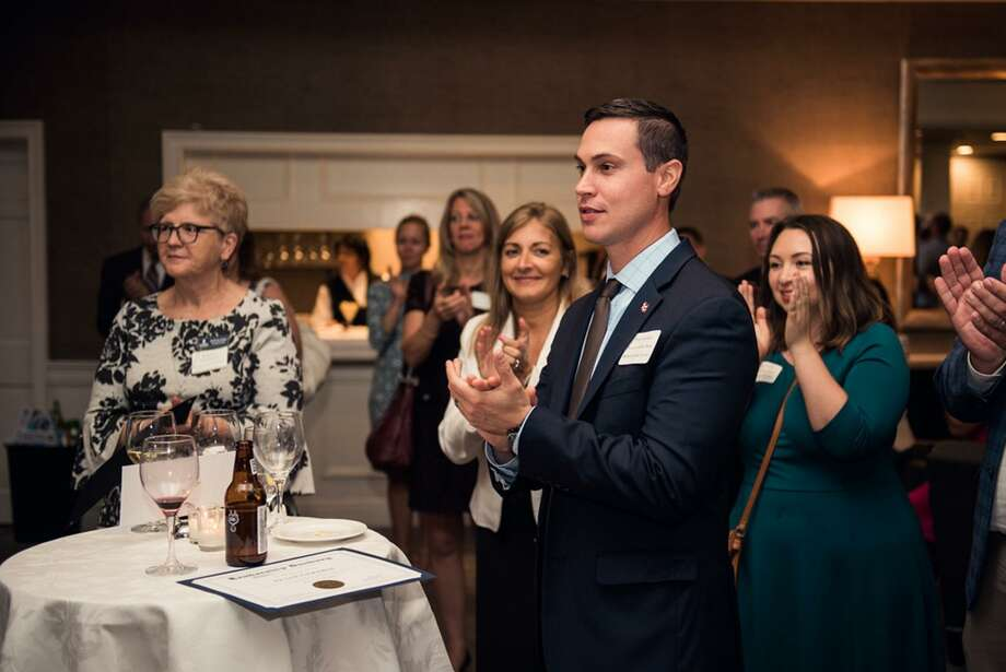 Attendees, including Peter Girardi from Newtown Savings Bank, cheer during graduation services as Leadership Danbury held its first alumni event Thursday, Sept. 20, 2018, at Ethan Allen Hotel in Danbury, Conn. Photo: Hearst Connecticut Media / The News-Times Contributed