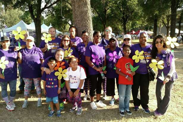 Members and supporters of the Isle at Kingwood's team, Kingwood Strong, pose for a photo at the 2016 Houston Walk to End Alzheimer?'s Nov. 5.