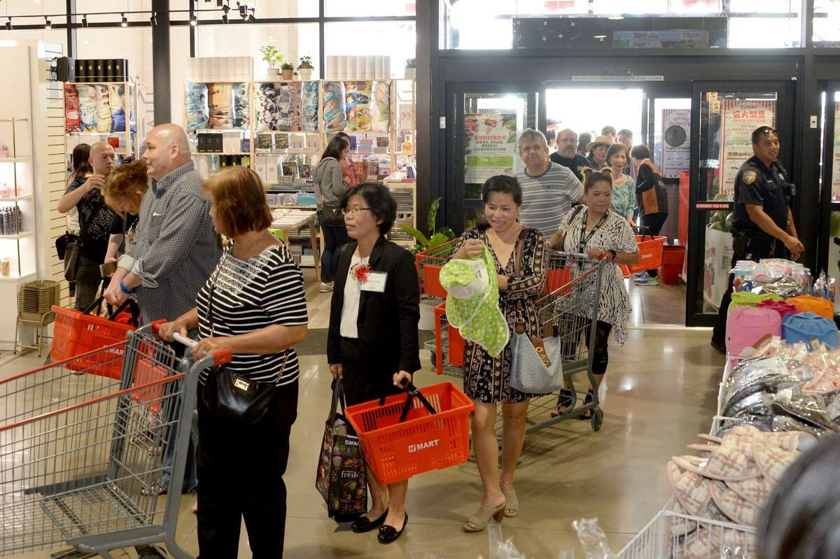 Shoppers enter the H Mart in the Katy Asian Town Mall during their grand opening, Katy, TX on Friday, September 21, 2018.