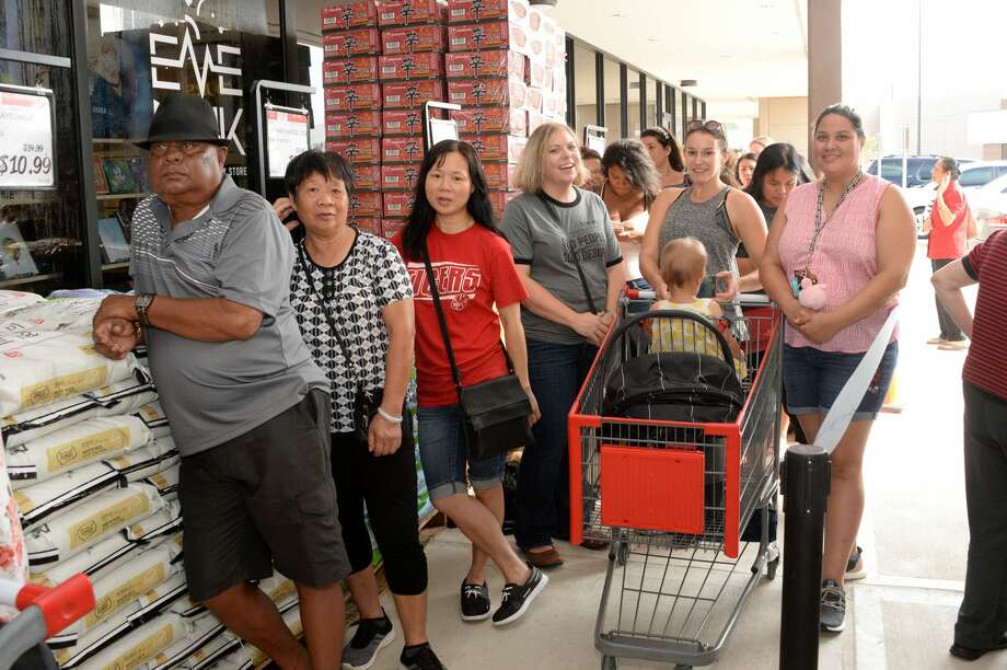 PHOTOS: Here's a look inside the new H Mart store...Shoppers await the grand opening of H Mart in the Katy Asian Town Mall, Katy, TX on Friday, September 21, 2018.>>>See photos of the new store that residents have waited months for... Photo: Craig Moseley/Staff Photographer