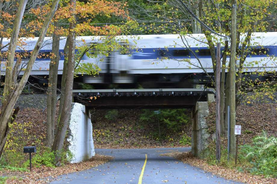 A Metro North commuter train heads south on the Danbury line last fall. Photo: H John Voorhees III / Hearst Connecticut Media / The News-Times