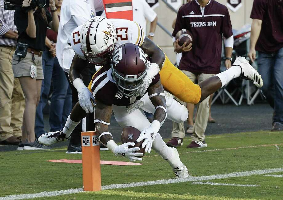COLLEGE STATION, TX - SEPTEMBER 15: Trayveon Williams #5 of the Texas A&M Aggies is knocked out of bounds by Nick Ingram #23 of the Louisiana Monroe Warhawks before he can reach the endzone in the first quarter at Kyle Field on September 15, 2018 in College Station, Texas. (Photo by Bob Levey/Getty Images) Photo: Bob Levey, Stringer / Getty Images / 2018 Getty Images