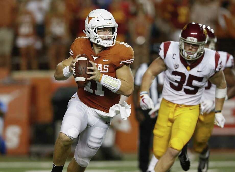 AUSTIN, TX - SEPTEMBER 15: Sam Ehlinger #11 of the Texas Longhorns rolls out to pass under pressure by Cameron Smith #35 of the USC Trojans in the first half at Darrell K Royal-Texas Memorial Stadium on September 15, 2018 in Austin, Texas. (Photo by Tim Warner/Getty Images) Photo: Tim Warner, Stringer / Getty Images / 2018 Getty Images
