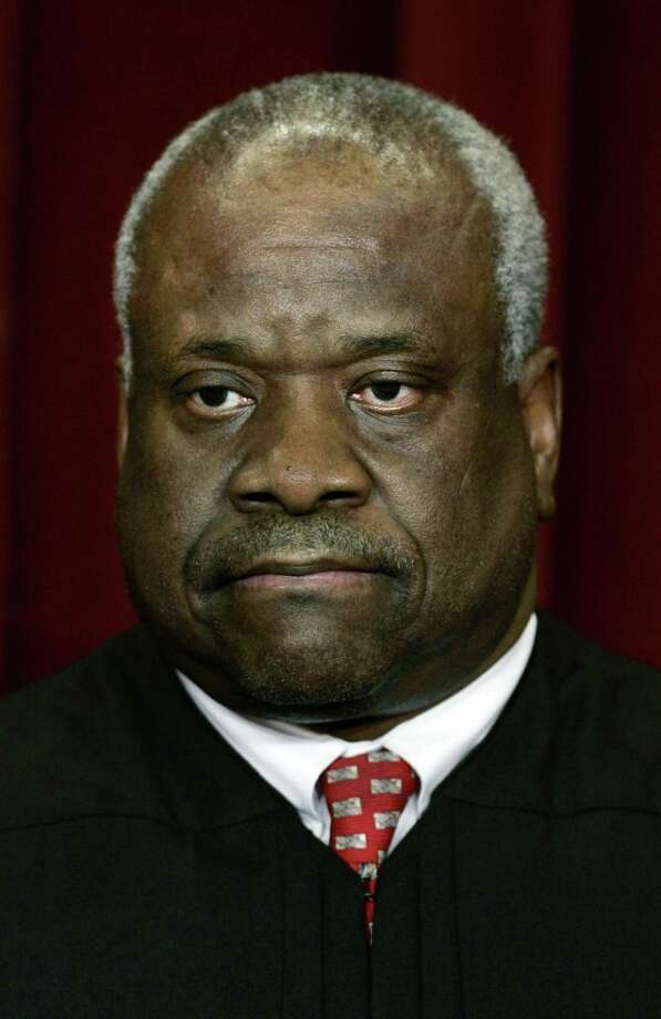 """** FILE** Associate Justice Clarence Thomas is photographed at the Supreme Court in Washington March 3, 2006. Breaking his 16-year public silence on his bitter confirmation hearings, Thomas says Anita Hill was a mediocre employee, who was used by political opponents to make claims she had been sexually harassed. Thomas writes about Hill, his former employee in two government agencies, in his autobiography, """"My Grandfather's Son"""", which goes on sale Monday, Oct. 1, 2007. (AP Photo/J. Scott Applewhite) Photo: J. SCOTT APPLEWHITE / ASSOCIATED PRESS / Stratford Booster Club"""