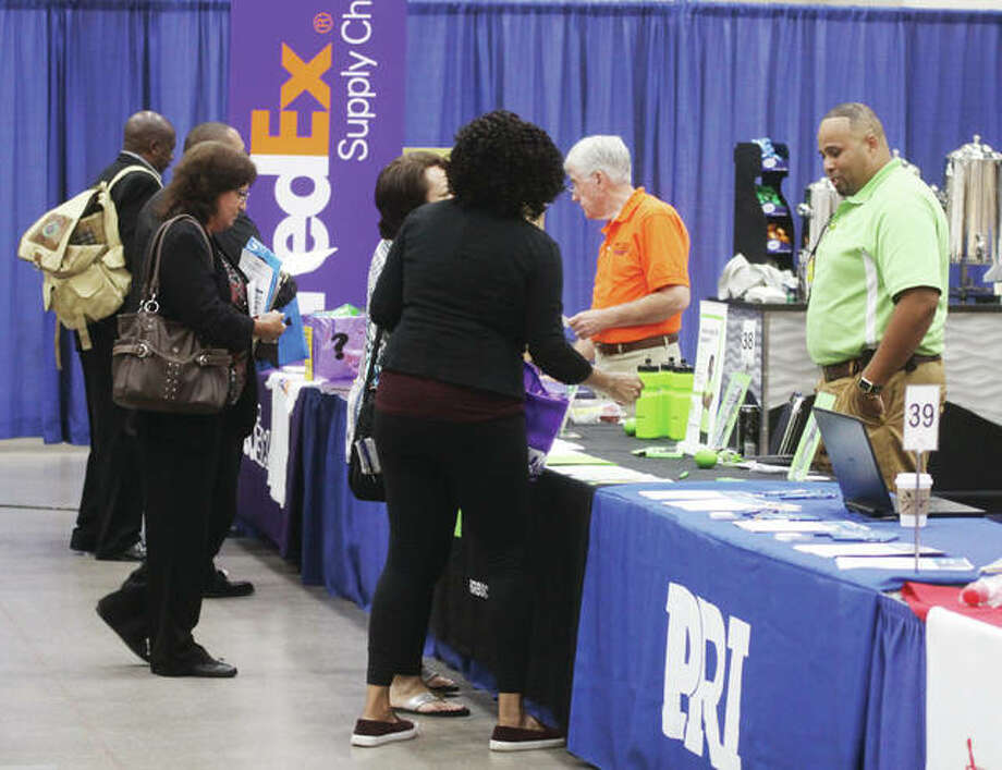 Job-seekers talk with representatives of various companies, schools and agencies during Jobs Plus '18, an annual job fair sponsored by the Madison County Employment and Training and St. Clair County Intergovernmental Grants departments. The event featured representatives of about 65 different employers and agencies who were providing information, talking to prospective employees, conducting interviews and in some cases making job offers on the spot. Photo: Scott Cousins | The Telegraph