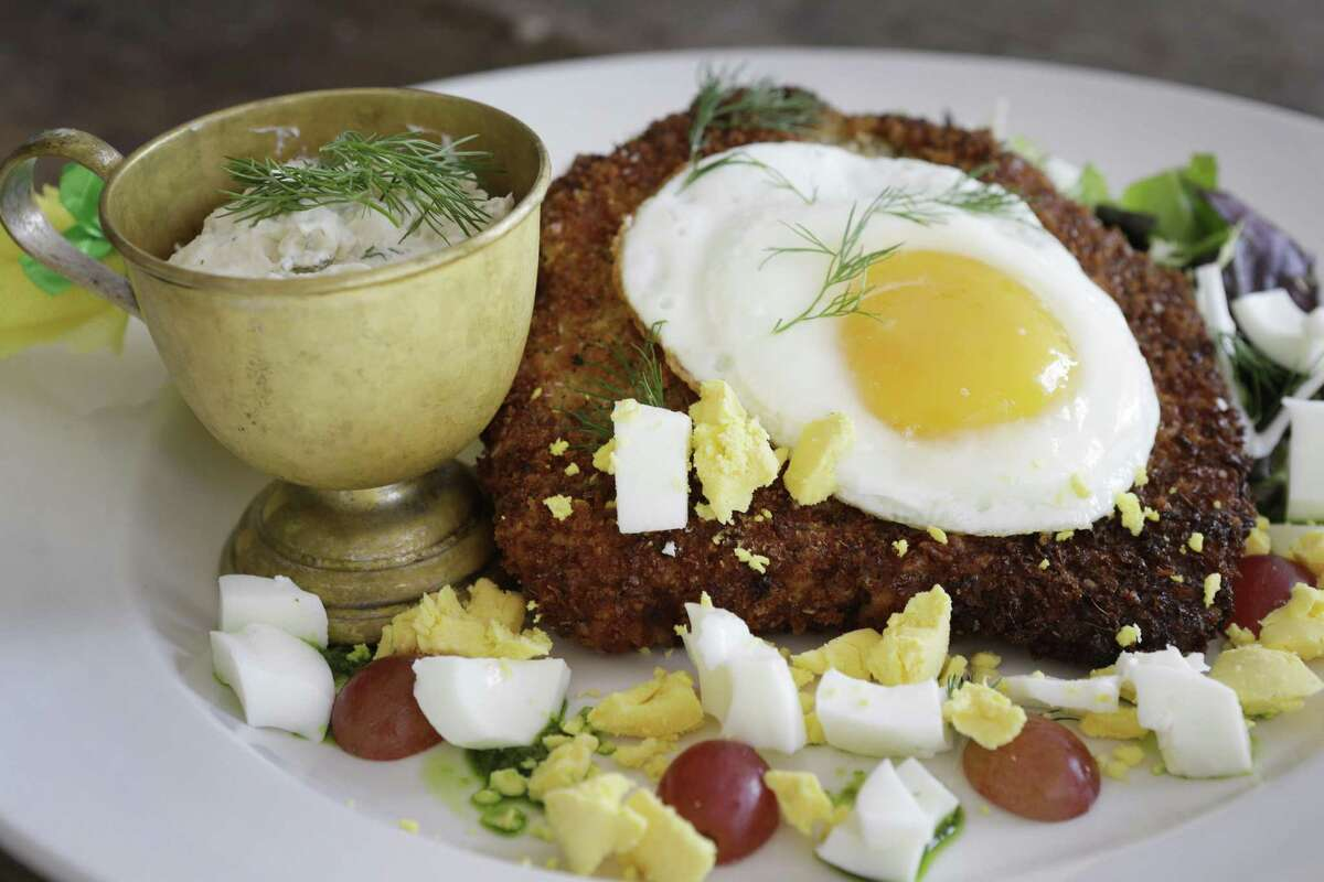Pork schnitzel with fried egg and potato salad at Brasserie 1895