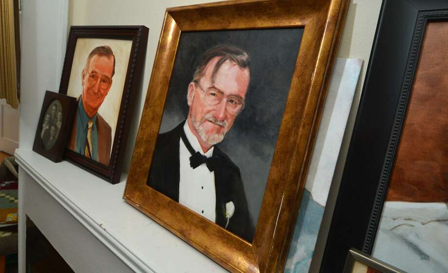 Portraits of John Frank Sr. rest on the mantle of the Frank home in Norwalk. Frank, who died in 2016, will be honored with the placement of a memorial at Calf Pasture Beach early Monday evening, Sept. 24. Photo: Alex Von Kleydorff / Hearst Connecticut Media / Connecticut Post