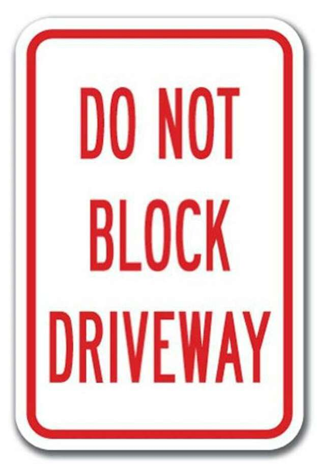 Willis PD plans to start enforcing a law that forbids blocking driveways after receiving multiple complaints around Willis ISD campuses. About 10 signs will be posting warning drivers that a violation is punishable by up to $500. Photo: Submitted Photo / Submitted Photo