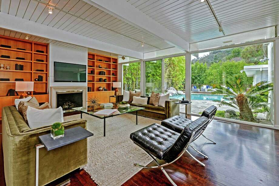 Taylor Swift has sold a home in Beverly Hills for $2.65 million. Earlier this year the singer-songwriter sold another house on the same street. The post-and-beam house features 2,950 square feet of living space, a climate-controlled wine cellar and pocket doors that open to a swimming pool. (Sotheby's International Realty) Photo: Sothebys International Realty / Los Angeles Times