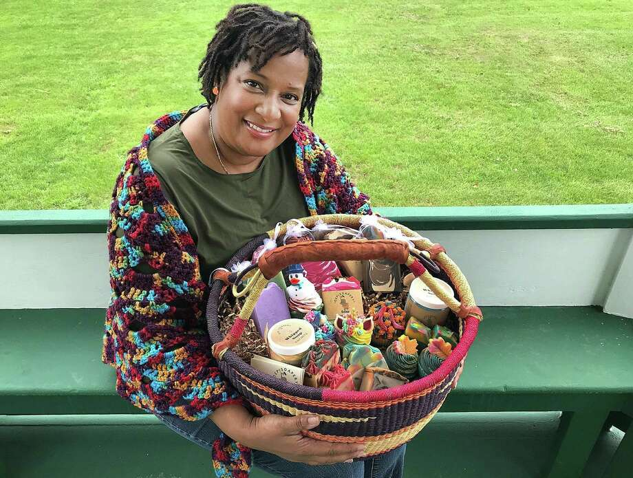 Deborah Freeman of OEP Soapery holds a basket with several of her products on Friday, Sept. 21, 2018, in New Milford, Conn. OEP Soapery makes decorative vegan soaps. Photo: Chris Bosak / Hearst Connecticut Media / The News-Times