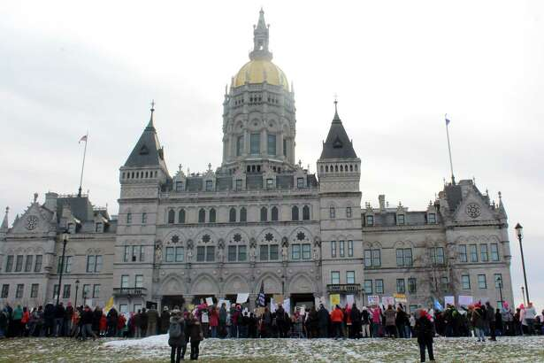 The Capitol building in Hartford. Under a new Connecticut law passed earlier this year, top hedge fund managers and other financiers could reap millions of dollars in tax savings.